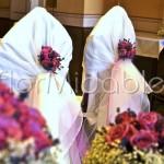 Dettaglio addobbo sedute sposi con rose e lavanda