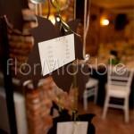 Dettaglio tableau mariage matrimonio autunnale con rami nocciolo