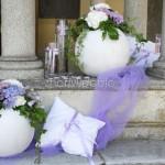 Allestimento matrimonio glamour con ortensie e rose lilla e candele