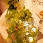 Centrotavola matrimonio con rose e orchidee verdi