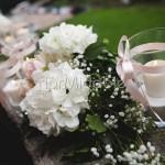 Cordone floreale con candele