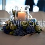 Centrotavola con candele in tonalità estive