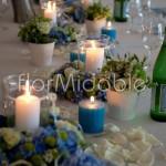 Allestimento tavolo reale con ghirlande floreali